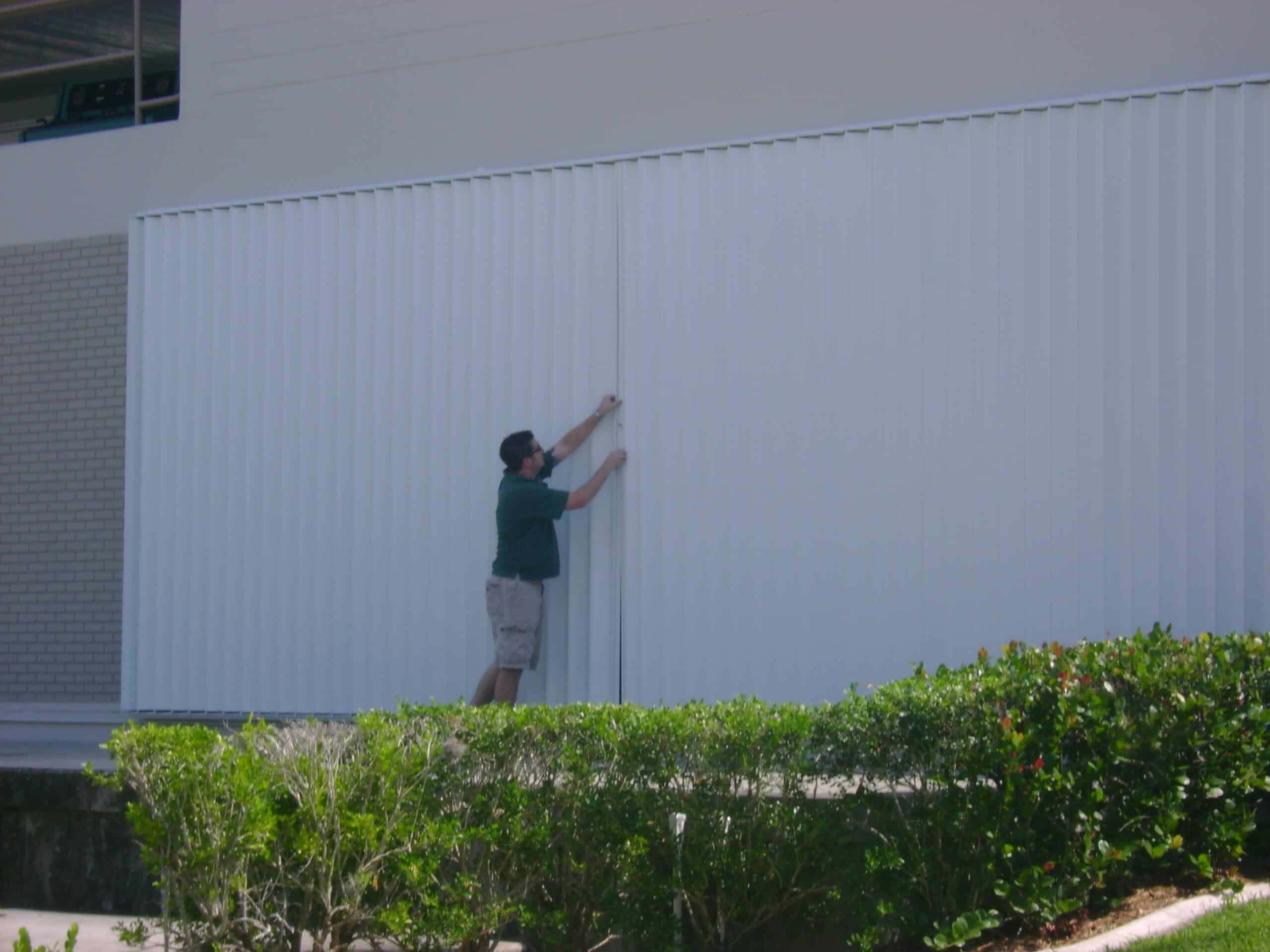 how to close accordion hurricane shutters