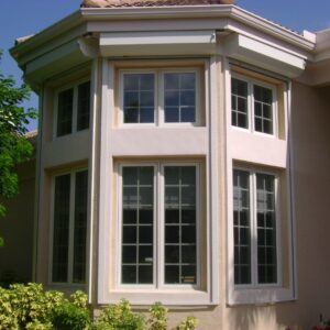 open rolling down hurricane shutters on a home