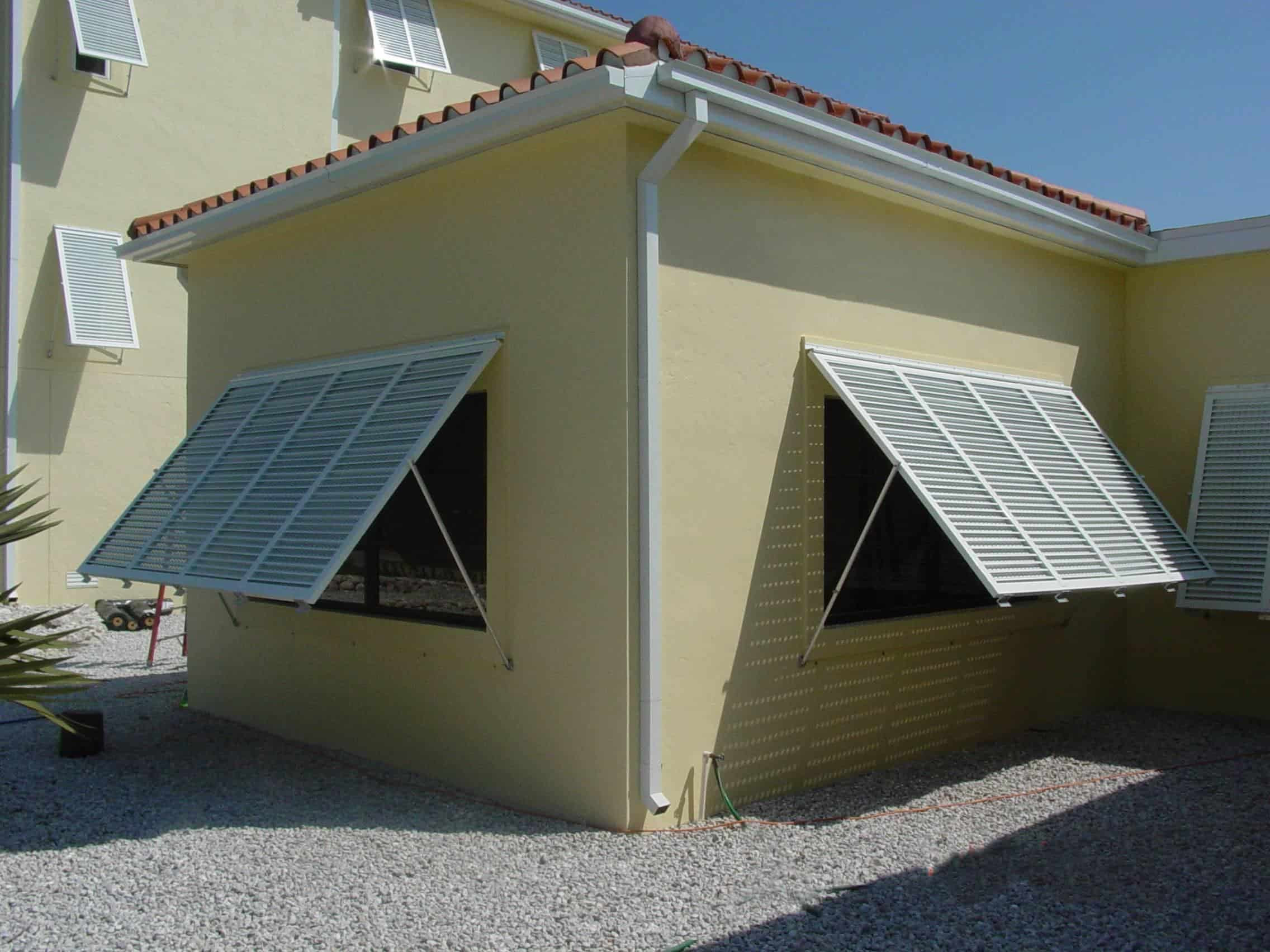 open PTX Bahama Shutters on yellow house