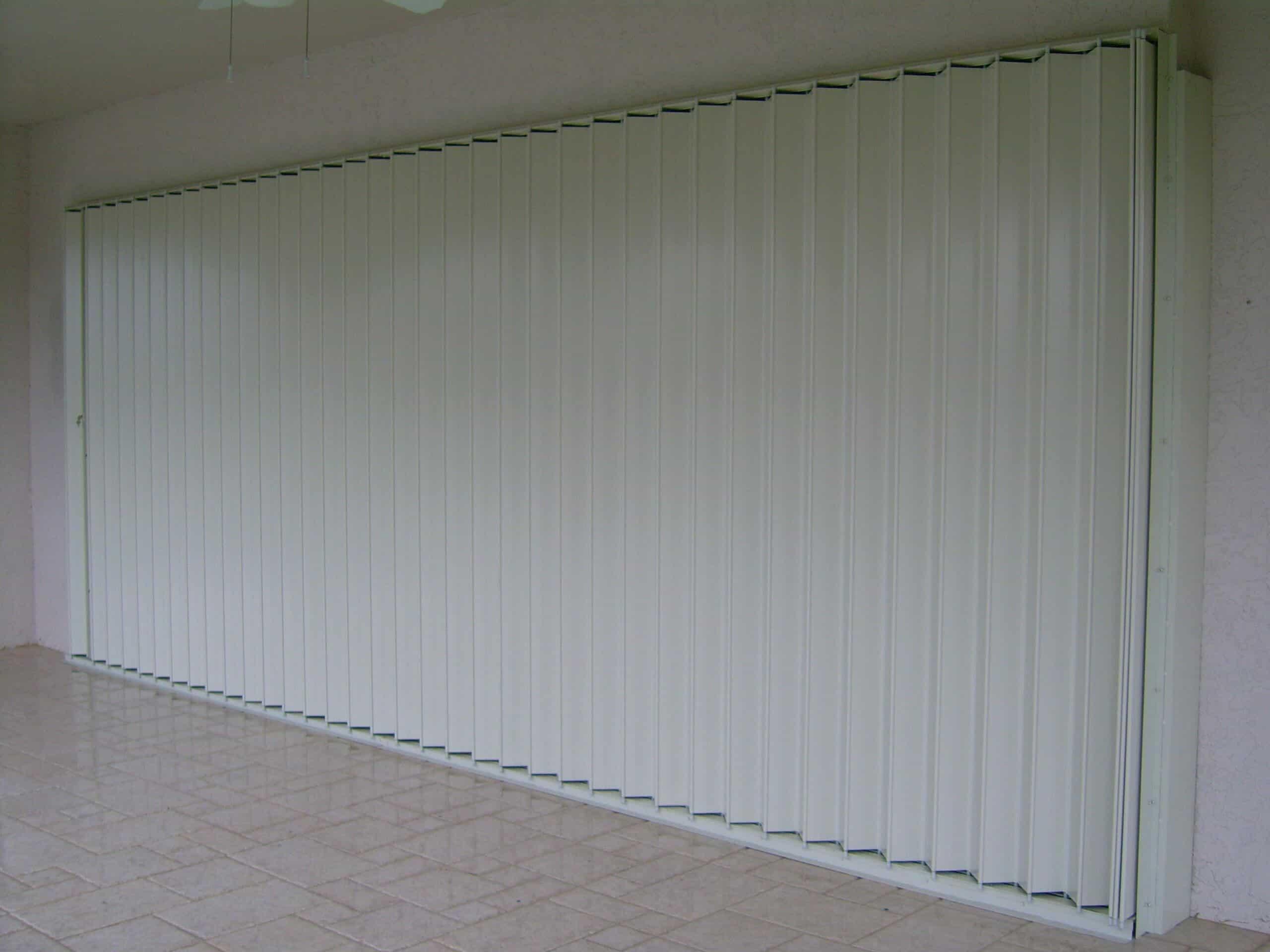 closed accordions protecting glass door