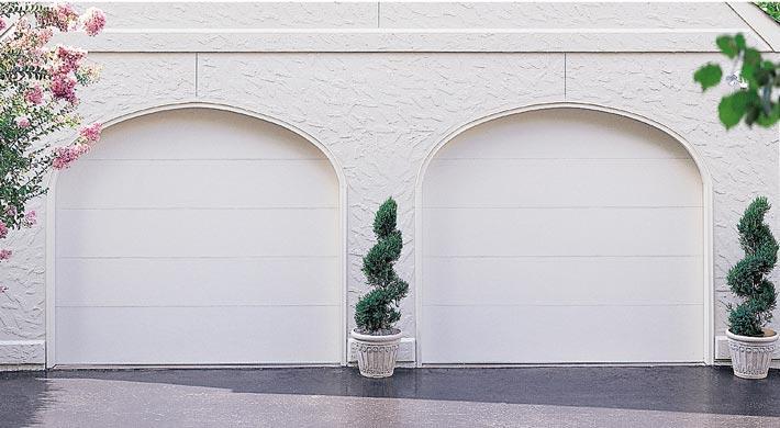 Eurex Garage Doors on a white house