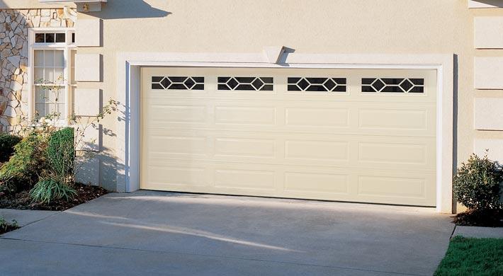 Hurricane Impact Garage Door Installed on tan house
