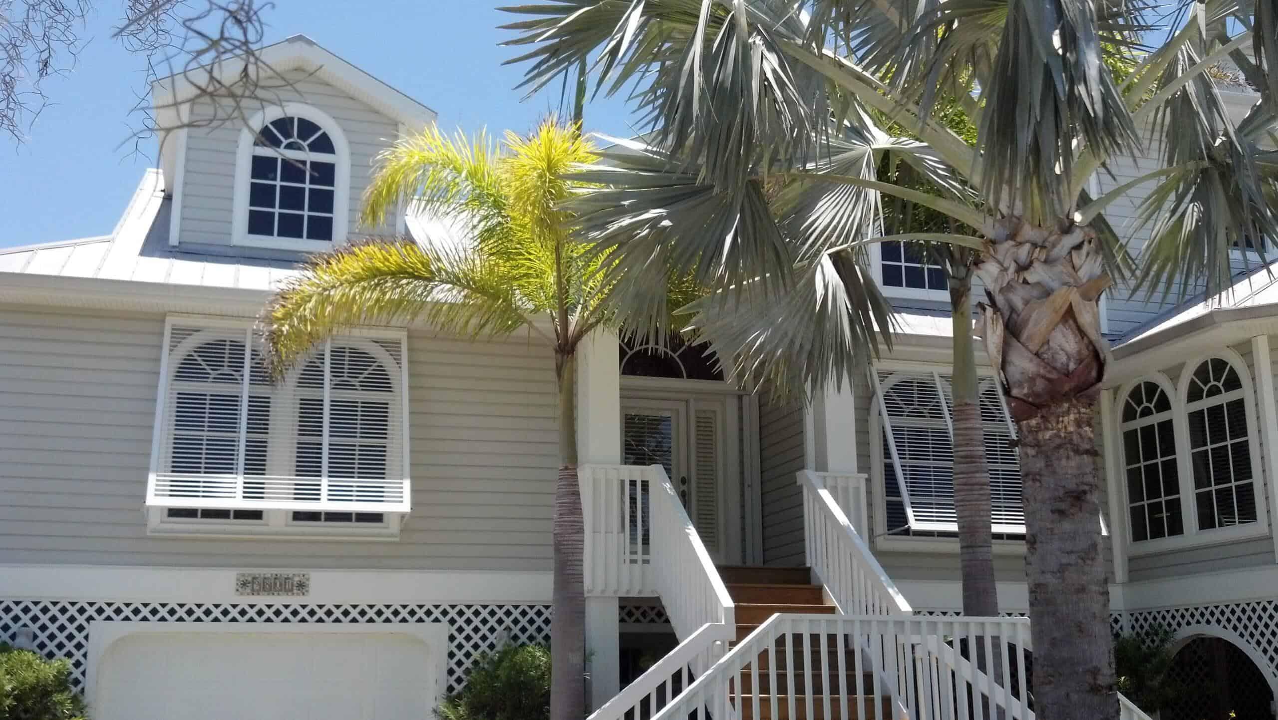Eurex Bahama Shutters on tan house