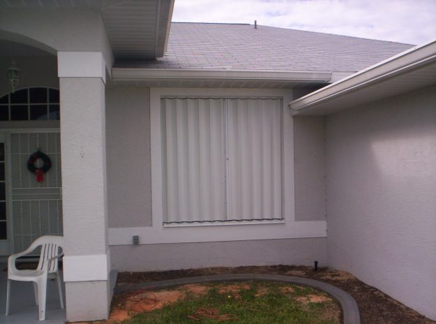 white aluminum accordion shutter installation