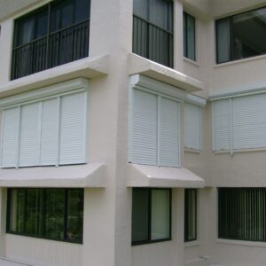 closed rolling shutters on a condo building