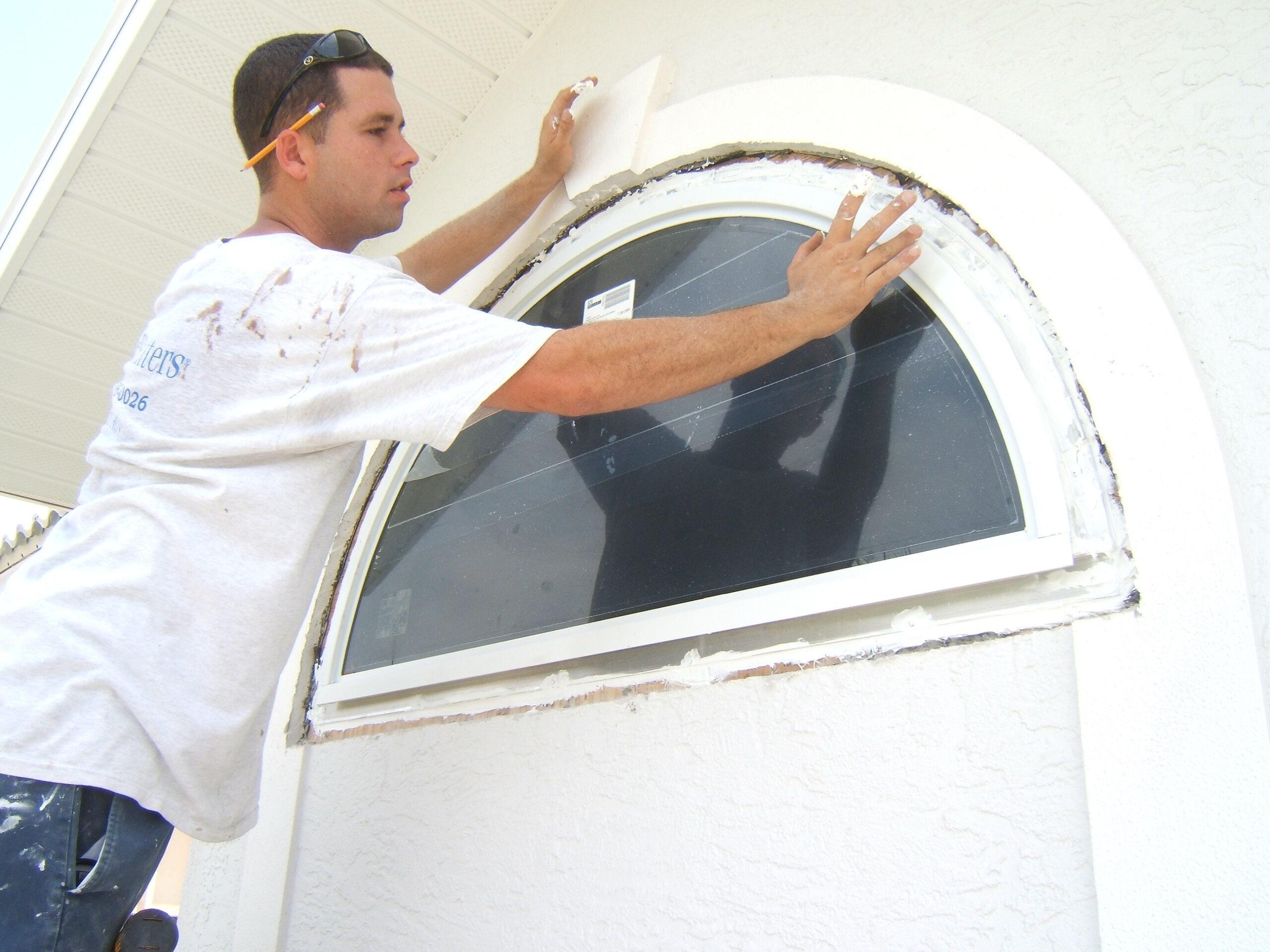 technician installing an impact window
