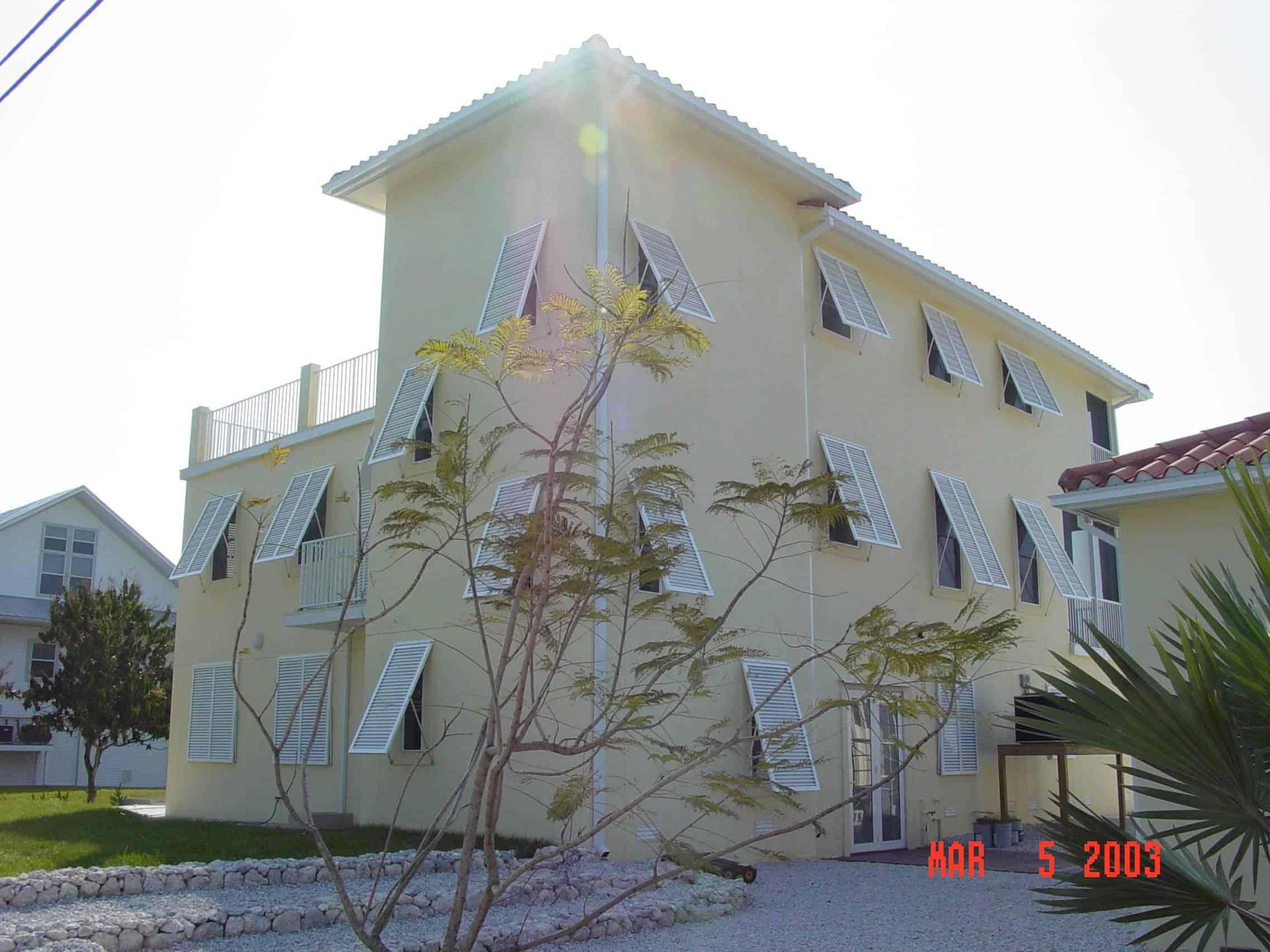 Eurex Bahama Shutters install on house