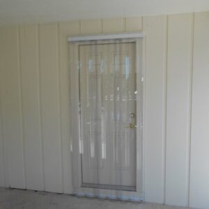 door with clear hurricane protection
