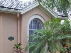 clear hurricane panels on tan house