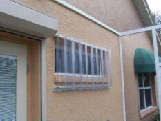 clear hurricane panels on peach house