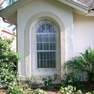 tan house with clear hurricane shutters