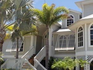 bahama style hurricane shutters on a south florida home