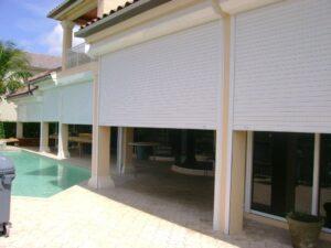 hurricane shutters on a tan house