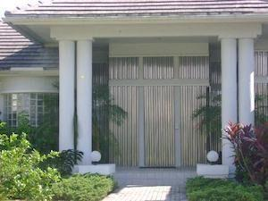hurricane shutter panels on a home in fort myers florida