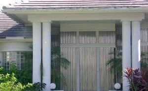 aluminum storm shutters on home in fort myers
