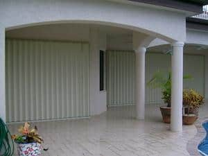 hurricane shutters installed on a white house