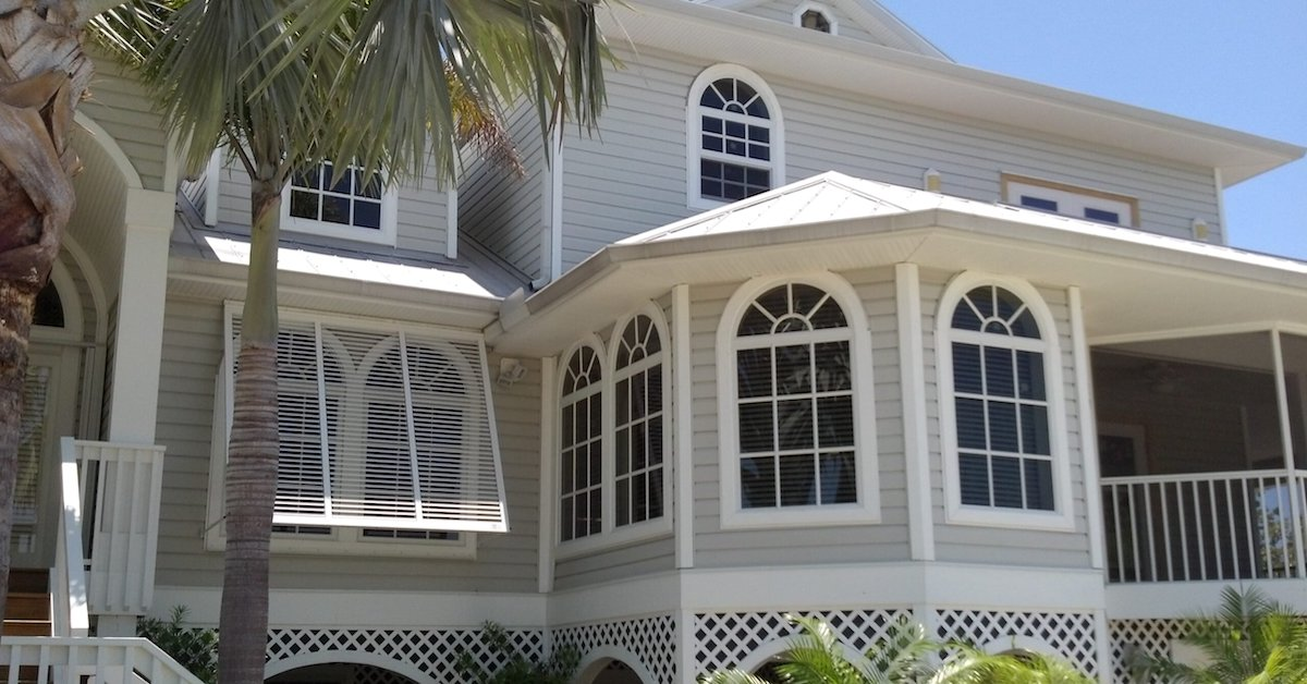 fort myers house with hurricane shutters