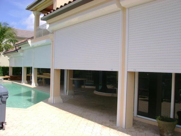 permanent hurricane shutters on a home near pool