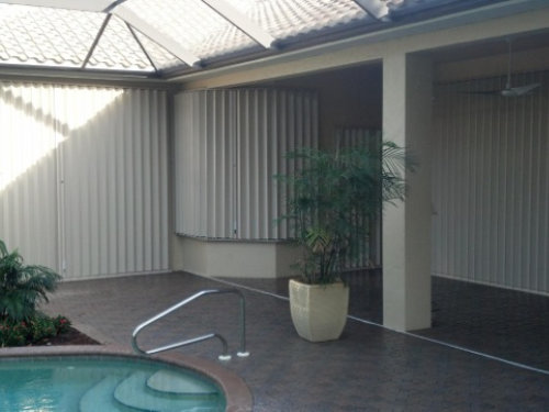 picture of accordion shutters on house with pool