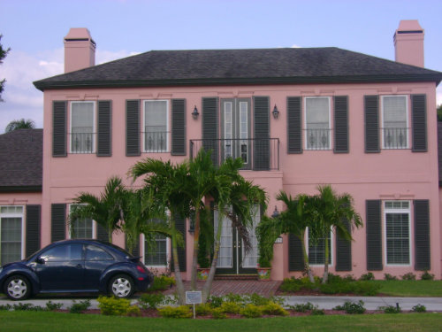 picture of colonial shutters on pink house