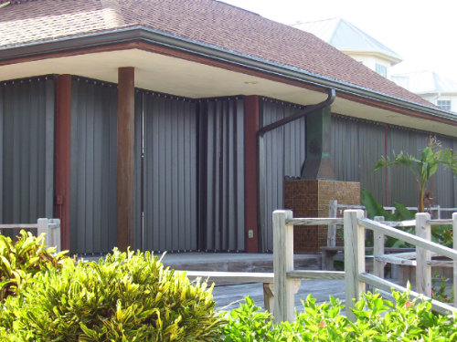 photo of beach house with accordion shutters