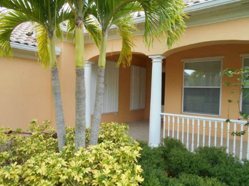 picture of accordion shutters on yellow house