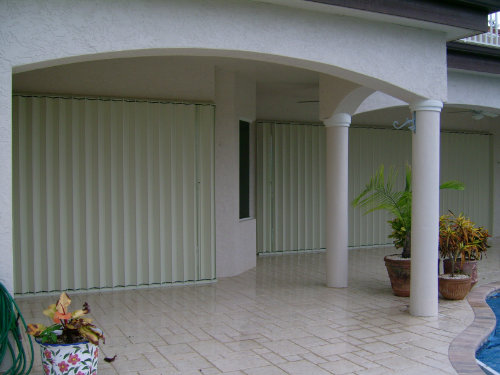 accordion shutters on patio picture