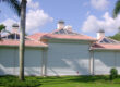 house with hurricane shutters in florida
